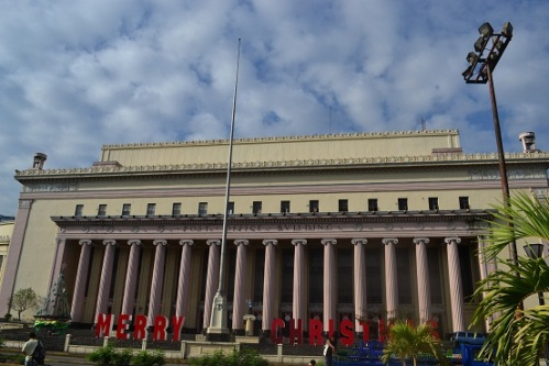 Turn right at the end of Jones Bridge and the Manila Post Office is standing in its grand decrepit state.