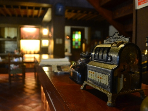 The interior is cozy and littered with antique memorabilia, adding vintage charm to the place.