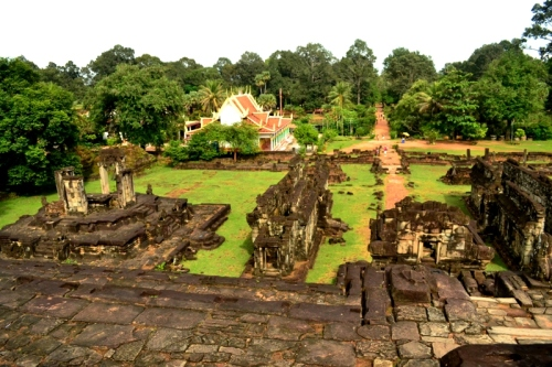 View from the steps of Prasat Bakong. You will notice a modern Buddhist temple on the right side of the east entrance.