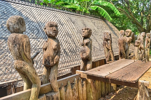 Surrounding the tomb house are sexually explicit wooden sculptures that depicts fertility and birth. These are sculpted using axes, chisels and knives.